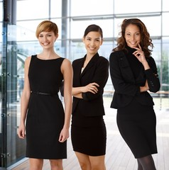 Interracial team of happy businesswomen