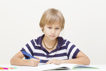 Child at home doing homework