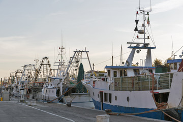 fishing boats in port canal in Rimini, Italy