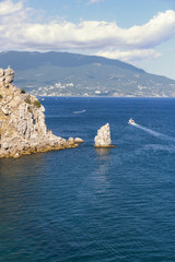Pleasure boats on the background of sea and rocks.