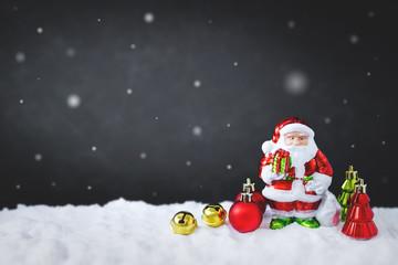 christmas background with santa, christmas ball, and bell on snow