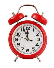 Red retro alarm clock at twelve o'clock, isolate.