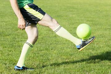 football player shots ball