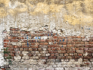 background texture from brick wall with cracked plaster