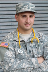 Friendly young military doctor in uniform