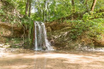 Waterfall on a mountain river Khodz. Russia, Krasnodar Krai