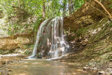 Waterfall in the forest. Russia, Krasnodar Krai