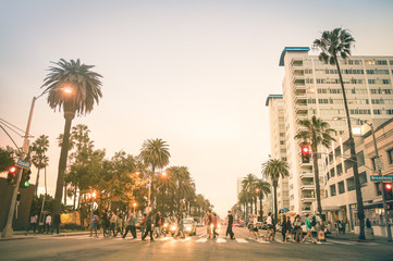 Printed roller blinds Los Angeles Locals and tourists walking on zebra crossing and on Ocean Ave in Santa Monica after sunset - Crowded streets of Los Angeles and California state - Warm desat twilight color tones with blurred people