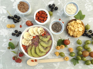 fruit yogurt smoothie, berries and seeds for decorating bowls