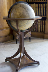 Vintage globe on a table in a library