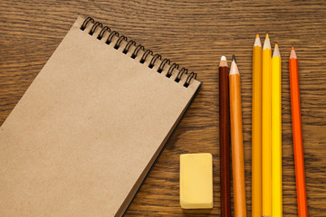 pencils and sketching notebook