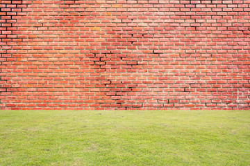 Red brick wall with green grass
