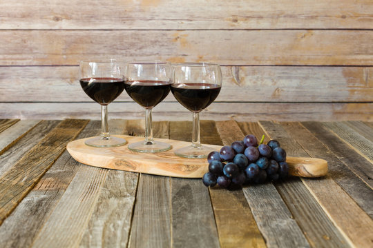 Red wine flight with grapes