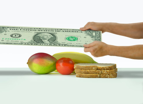 A man is stretching  a dollar to cover food expenses and the general cost of living representing financial problems and struggles.