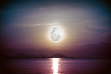 Romantic scenic with full moon on sea to night. Reflection of moon.