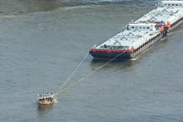 Tug boat service, chao phaya river bangkok, thailand