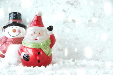 Santa claus with snowman and snowfall