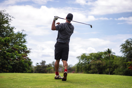 Golfer taking a bad swing off the tee, shanking the ball