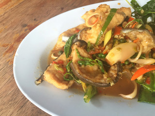 horizontal photo of fried spicy Mekong giant catfish with herb