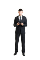 Young and confident businessman on white