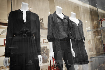 Dressed mannequins at boutique window
