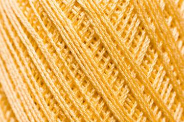 Golden knitting thread texture, handiwork backdrop. Bright handiwork background, crochet iris string, Leisure, hobby, needlework concept
