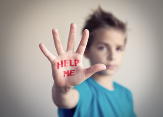 Little boy asking for help