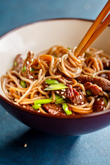 Asian soba noodles with beef and sesame
