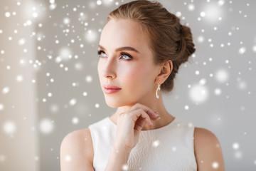 beautiful woman in white with diamond earring