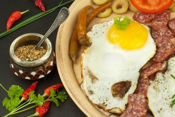 Fried Eggs on a plate. A hearty breakfast for athletes. Healthy food.