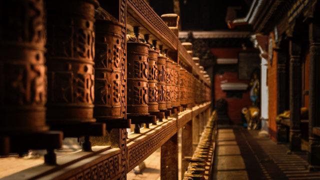 Wooden Prayer Wheels in a temple in Kathmandu, Nepal