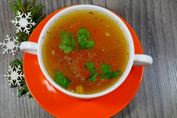 Traditional broth served at Christmas dinner - energy and warming meal on a cold day