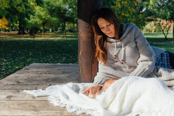 Mom and newborn outdoors