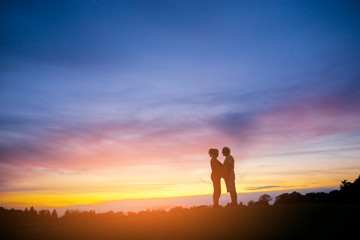 Couple standing on sunset background. Silhouettes of man and woman. Everything for you. Happiness of all life.