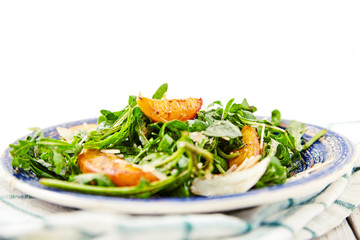 Vegetarian gourmet salad with arugula and peaches
