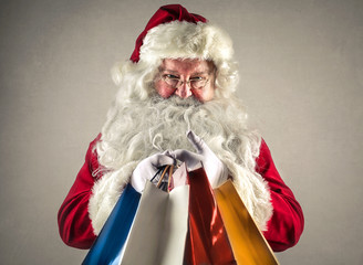 Smiling Santa Claus holding presents