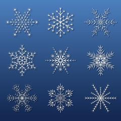 set of white snowflakes with shadow