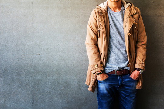 Men's casual outfits standing over gray grunge background with space, beauty and fashion concept