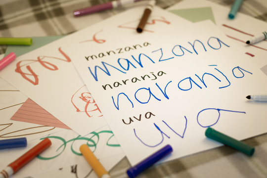 Spanish; Kids Writing Name of the Fruits for Practice