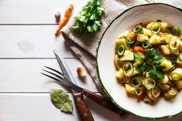 Tasty food. Vegetable stew on a wooden background. The rustic style.