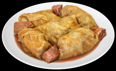 Plateful Of Cabbage Rolls Stuffed With Minced Meat Cooked In Tomato Sauce With Smoked Pork Ham Chunks