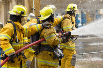 Firefighters training, foreground is drop of water springer, Sel