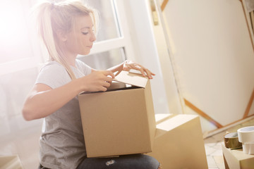 Young woman moving to her new home