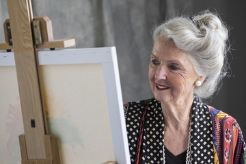 Portrait of a senior aged woman painting a picture