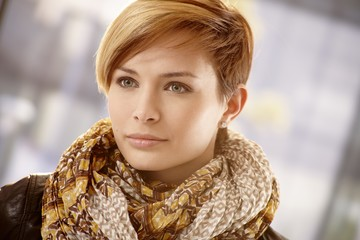 Closeup of young woman in scarf on a spring day