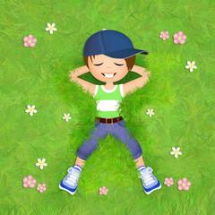 little boy lying in the grass