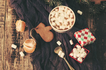 Mug filled with hot chocolate and marshmallows. Christmas background.