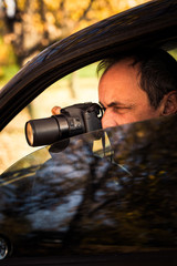 undercover man hidden in car take photo