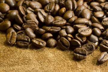 Coffee beans on leather and burlap