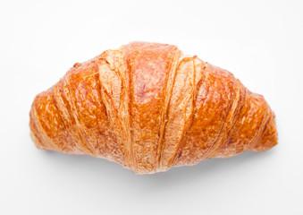 Fresh crispy croissant for breakfast on white